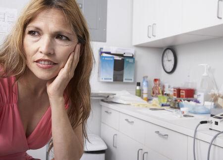 handsfree: Hispanic woman at doctor's office