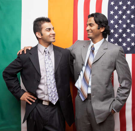 Indian businessmen in front of flags Stock Photo