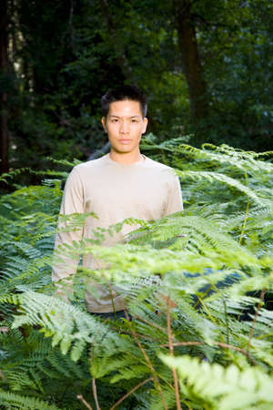 squatter: Asian man in woods