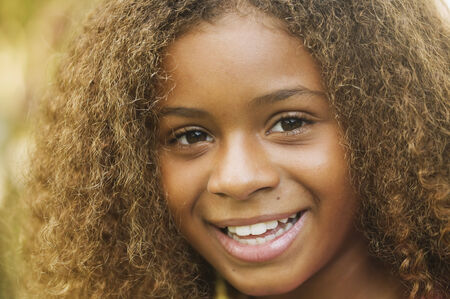 daydreamer: Close up of African American girl smiling