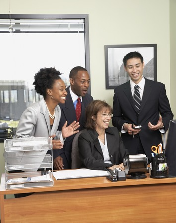 Multi-ethnic businesspeople cheering