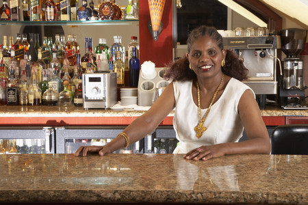 selling service: Portrait of African female bartender