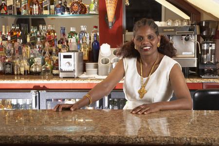 clerk: Portrait of African female bartender