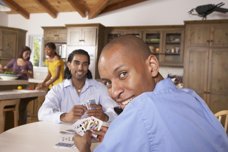 entertaining area: Multi-ethnic friends playing cards