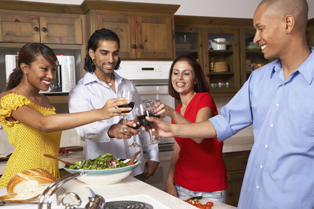 Multi-ethnic couples toasting with wine Imagens - 35736752