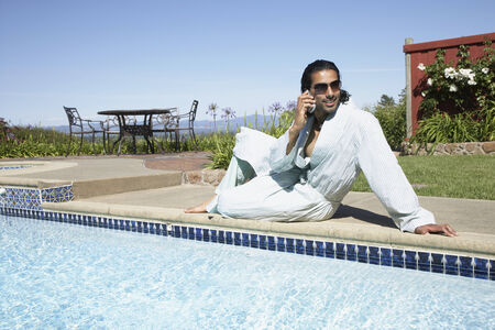 girl in full growth: Indian man talking on cell phone
