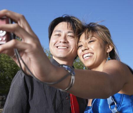 sidewalk talk: Asian couple taking own photograph