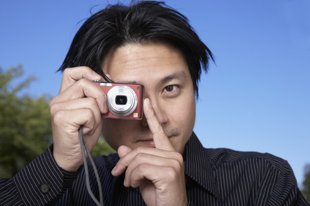 taking a wife: Asian man taking photograph