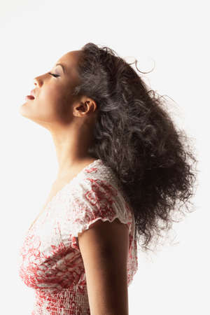 pacific islander ethnicity: Profile of African woman with eyes closed LANG_EVOIMAGES