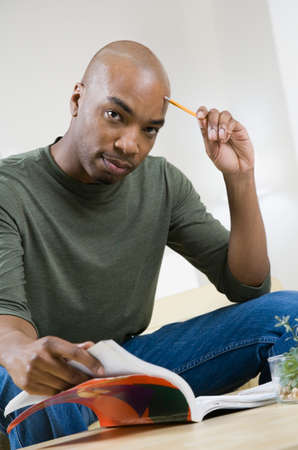 well beings: African American man reading text book