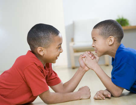two persons only: African American brothers arm wrestling LANG_EVOIMAGES