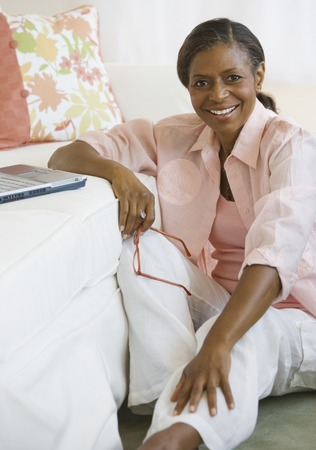 seventy two: Senior African American woman next to laptop