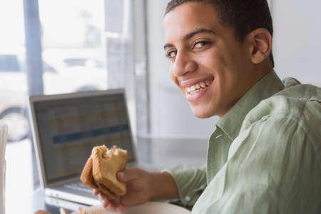 milepost: Mixed Race boy eating sandwich