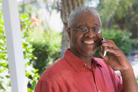 slanting: African American man talking on cell phone