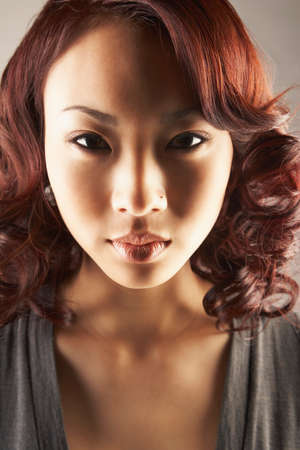 invariable: Asian woman with nose ring LANG_EVOIMAGES