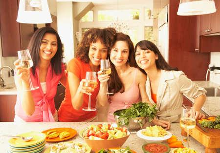 fluency: Multi-ethnic female friends drinking wine LANG_EVOIMAGES
