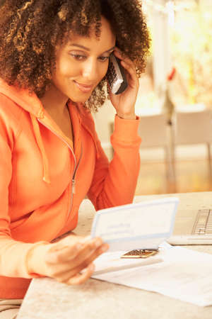 solicitous: African American woman paying bills