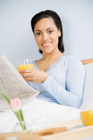 african american woman: African American woman reading newspaper