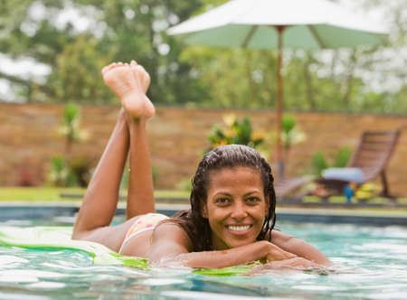 of african descent: African woman in swimming pool