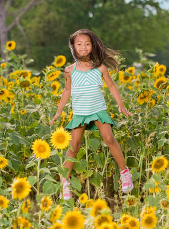 sopping: African girl jumping in flower patch