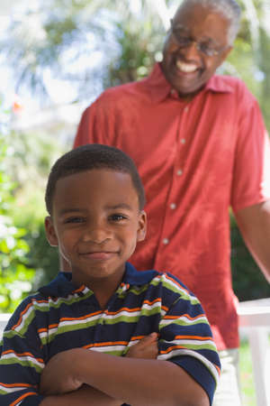 African American grandfather smiling at grandson