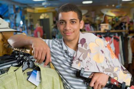 slanting: African male teenager clothing shopping