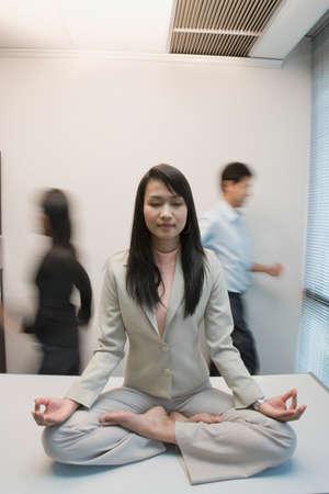 vietnamese ethnicity: Asian businesswoman meditating