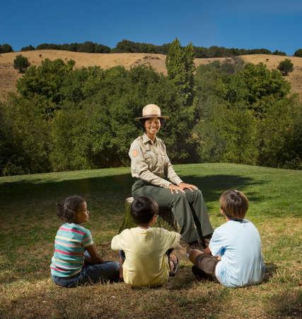 joining forces: Multi-ethnic children listening to Park Ranger
