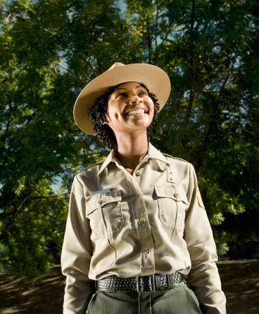 African American female Park Ranger looking up