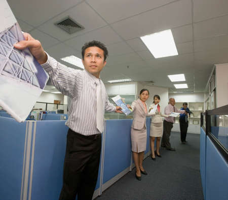 three persons only: Multi-ethnic businesspeople passing paperwork