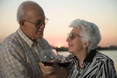 30 years old married couple: Senior Hispanic couple drinking wine