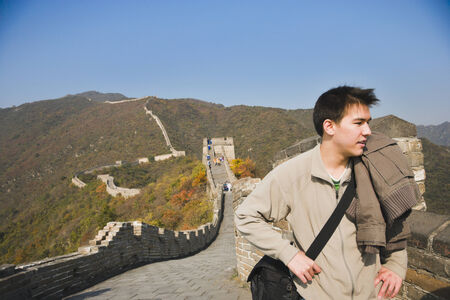 lighthearted: Asian man on Great Wall of China