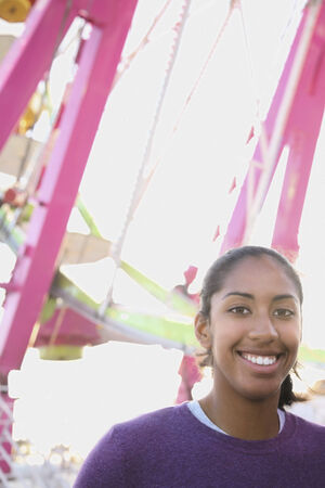 rebelling: African American girl in front of Ferris wheel