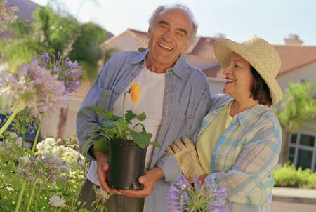 talker: Senior Hispanic couple gardening