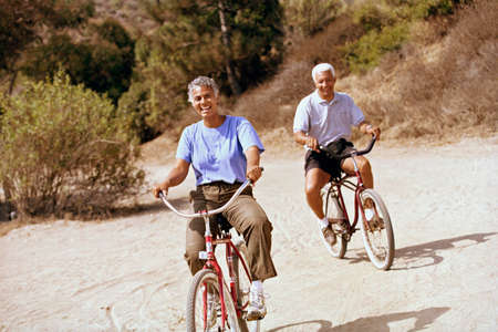 prevailing: Senior African American couple riding bicycles LANG_EVOIMAGES
