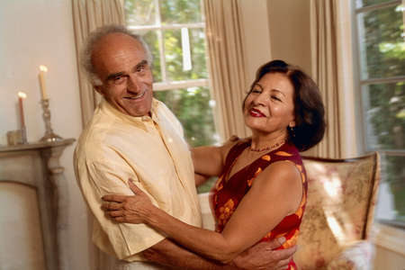Senior Hispanic couple dancing LANG_EVOIMAGES