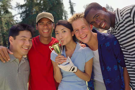 liberating: Ethnic-ethnic friends with trophy LANG_EVOIMAGES