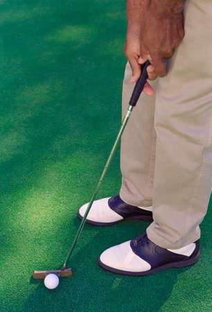 pj's: African American man playing golf