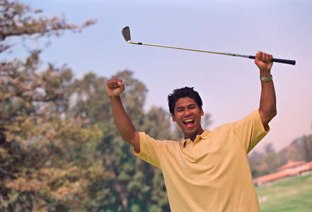 lower section view: Hispanic man cheering with golf club