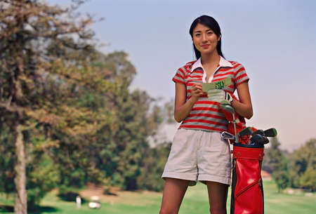 prevailing: Asian woman on golf course