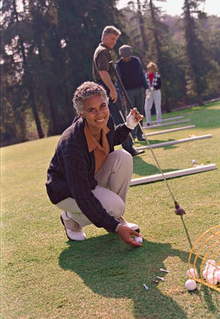 ceasing: Senior African American woman playing golf