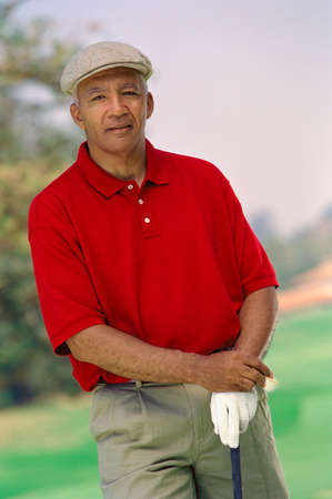 saturating: Senior African American man with golf club