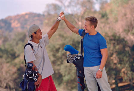 exactitude: Multi-ethnic men on golf course LANG_EVOIMAGES