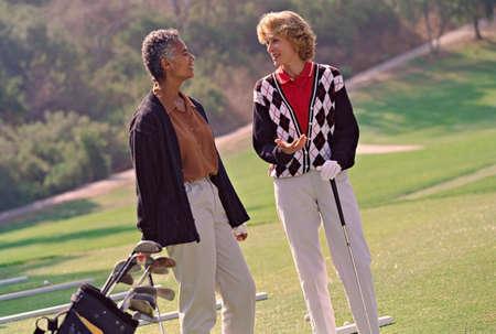 squatter: Multi-ethnic senior women on golf course LANG_EVOIMAGES