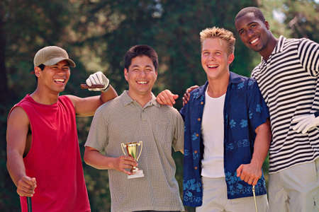 lower section view: Multi-ethnic men with golf trophy LANG_EVOIMAGES