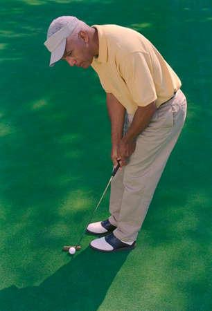 prevailing: Senior African American man playing golf