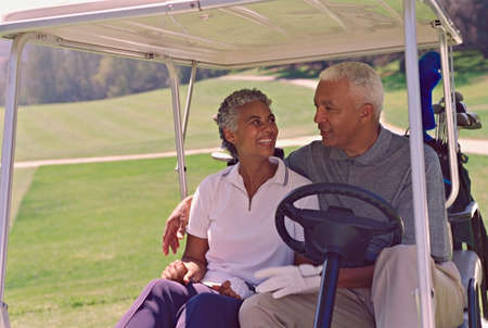 prevailing: Senior African American couple in golf cart