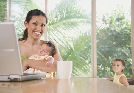 lighthearted: Hispanic mother holding baby