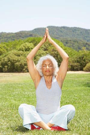 musing: Senior Hispanic woman practicing yoga LANG_EVOIMAGES