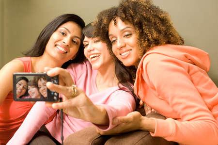 bathtowel: Multi-ethnic women taking own photograph